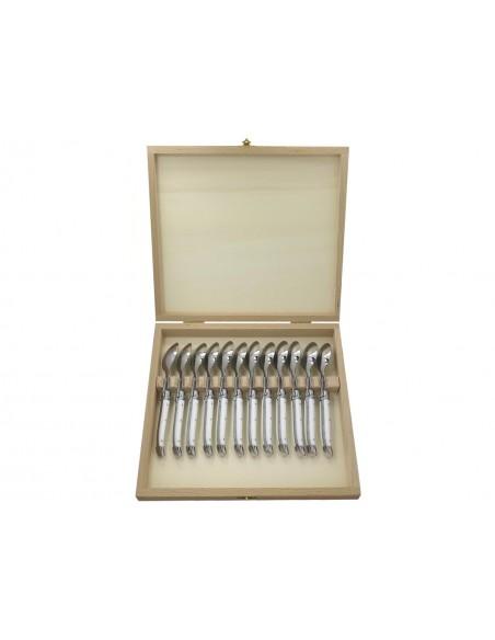Petites cuillères Laguiole avec manche en corian blanc et mitres inox brillant. Lavables en machine.