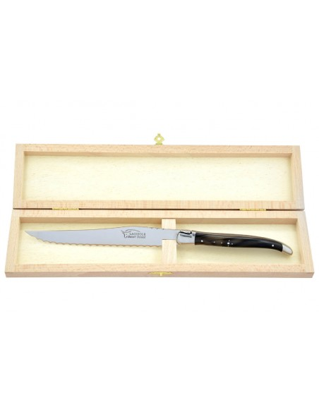 Couteau à pain Laguiole. Finition inox brillant avec manche galbé en pointe de corne foncée